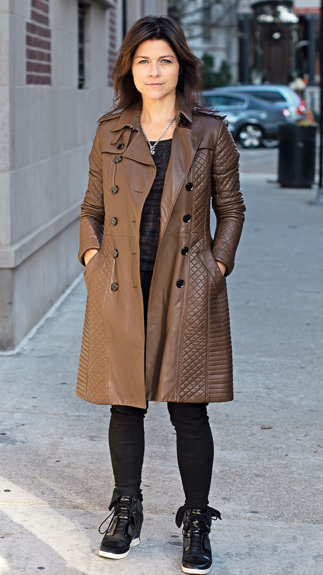 kara mann photographed wearing a seasonal trench coat | art of the